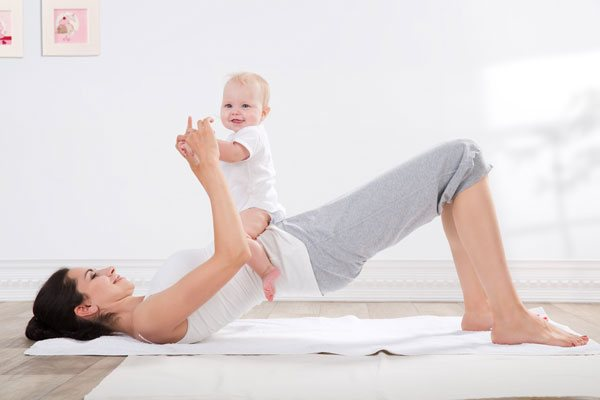 mother with baby in clean home